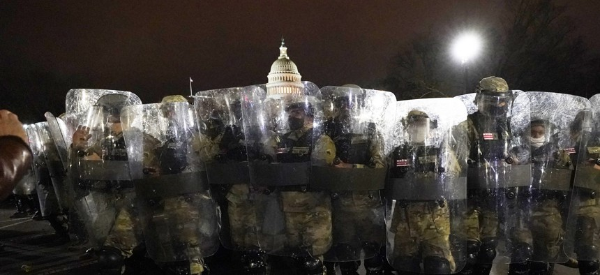 DC National Guard stand outside the Capitol, Wednesday, Jan. 6, 2021, after a day of rioting protesters.