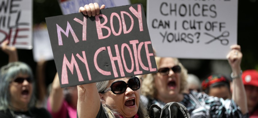 In this May 21, 2019 file photo, a group gathers to protest abortion restrictions at the State Capitol in Austin, Texas.