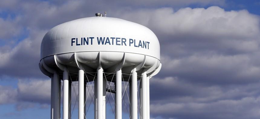 The Flint Water Plant water tower is seen in Flint, Mich. in 2016.
