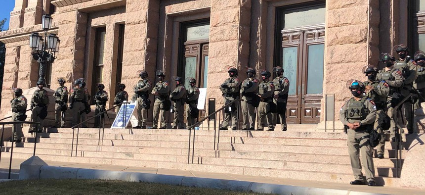 Texas state troopers wearing riot gear stand guard outside the Capitol in Austin, Texas, on Tuesday, Jan. 12, 2021, for the opening of the legislative session.