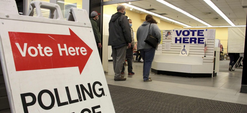 Residents in Anchorage, Alaska, take part in early voting in a mall in Alaska's largest city on Friday, Oct. 30, 2020.