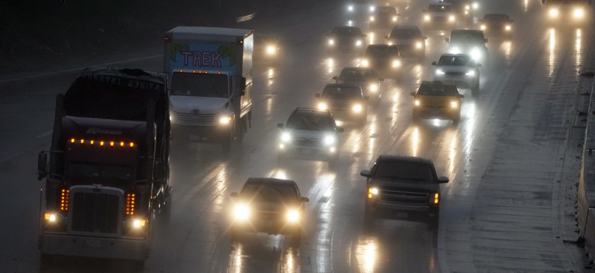 Traffic makes its way on a rain-soaked Interstate 5, Monday, Dec. 28, 2020, in Sun Valley, Calif.