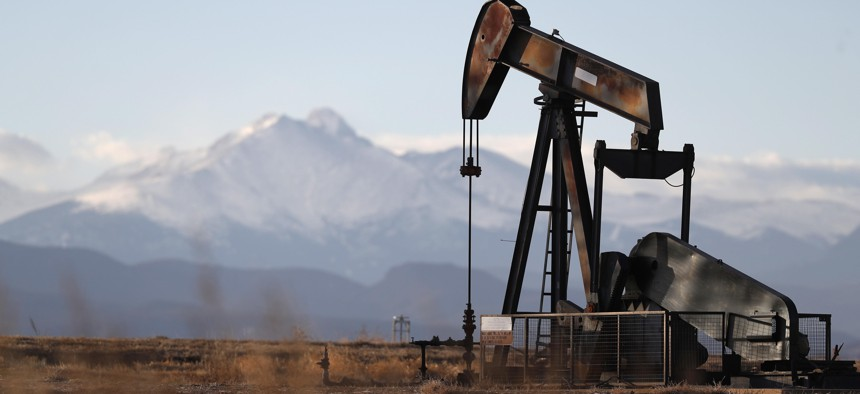 This Dec. 22, 2018, file photo shows a pump jack over an oil well along Interstate 25 near Dacono, Colo.