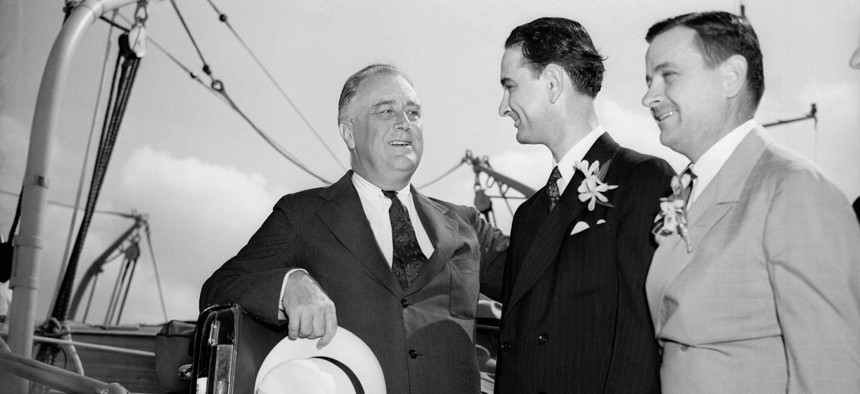 President Franlkin D. Roosevelt, left, is greeted by congressman Lyndon Johnson, D-Texas, center, and Texas Gov. James V. Allred, as he steps off the presidential yacht Potomac in Galveston, May 12, 1937.