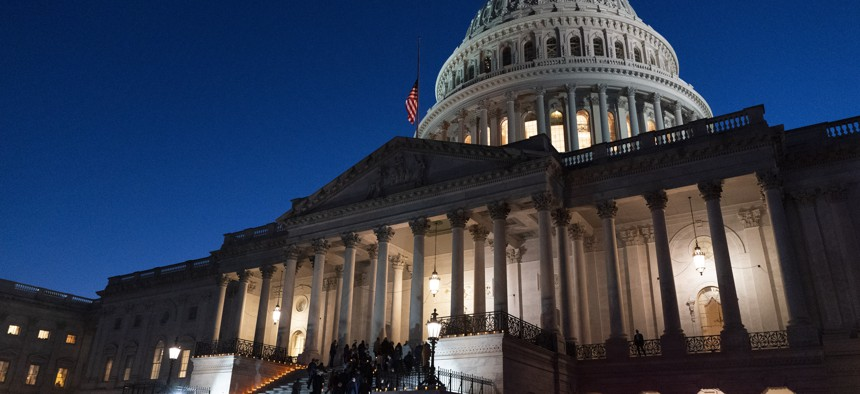 A bipartisan group of members of the House and Senate, walk back up the steps of the Capitol after holding a moment of silence for 500,000 U.S. COVID-19 deaths, Tuesday, Feb. 23, 2021, in Washington.