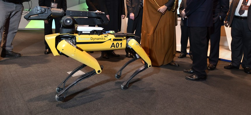"""A model of the """"SpotMini"""" robot dog by Boston Dynamics seen at an event in 2018."""