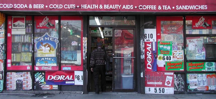 A patron walks into supermarket deli in New York City.