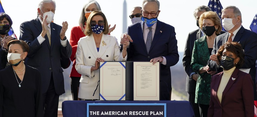 House Speaker Nancy Pelosi of Calif., and Senate Majority Leader Chuck Schumer of N.Y., poses after signing the $1.9 trillion COVID-19 relief bill during an enrollment ceremony on Capitol Hill, Wednesday, March 10, 2021, in Washington.