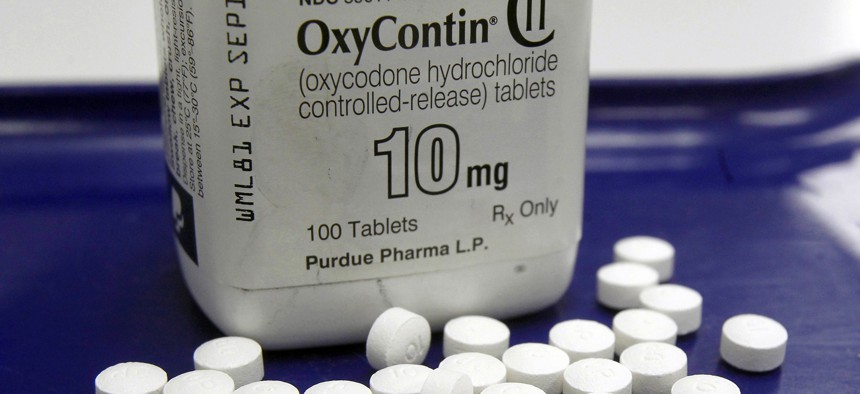 This Feb. 19, 2013, file photo shows OxyContin pills arranged for a photo at a pharmacy in Montpelier, Vt.