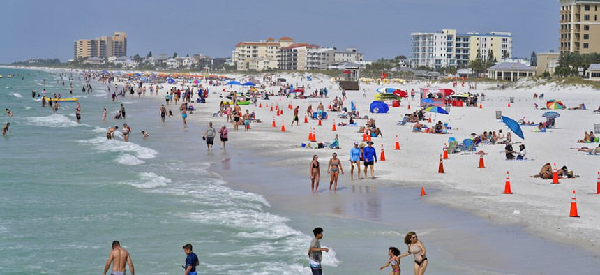 Beachgoers take advantage of the sun, sand, and surf as they spend time on Clearwater Beach Tuesday, March 2, 2021, in Clearwater, Fla., a popular spring break destination, west of Tampa.
