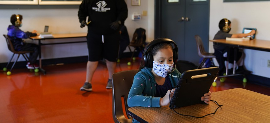 In this Aug. 26, 2020, file photo Los Angeles Unified School District students attend online classes at Boys & Girls Club of Hollywood in Los Angeles.