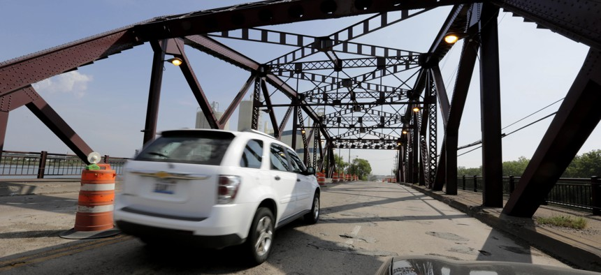 """In this Sept. 11, 2013 file photo, vehicles drive on the 130th St. bridge over the Little Calumet River in Chicago that was classified as both """"structurally deficient"""" and """"fracture critical"""" in federal data for 2012."""