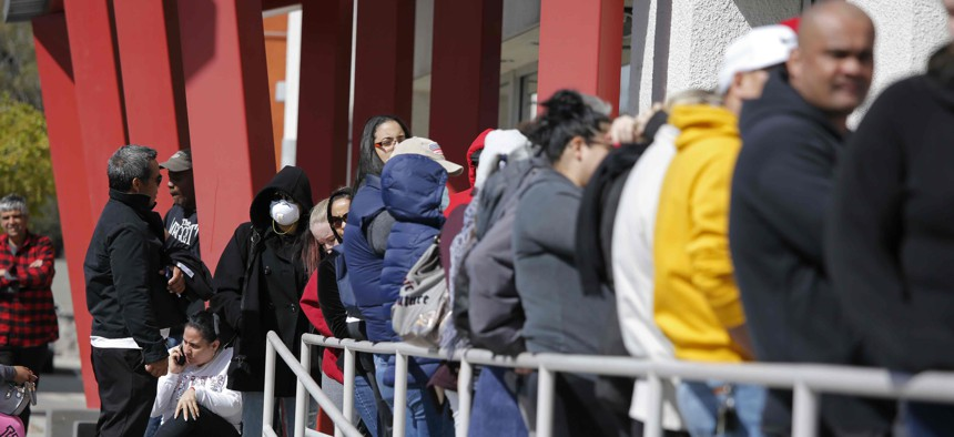 People wait in line for help with unemployment benefits at the One-Stop Career Center in Las Vegas.
