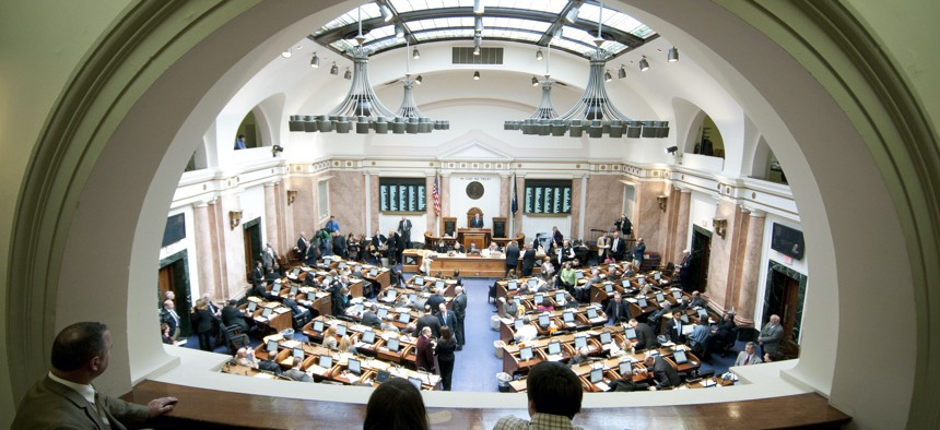 The Kentucky House of Representatives conducts first-day business Tuesday, Jan. 3, 2012, in Frankfort, Ky.