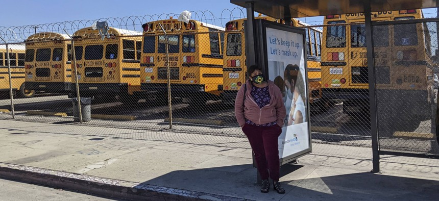 In this March 16, 2021, photo, school buses remain parked in Los Angeles.