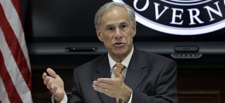 Texas Gov. Greg Abbott speaks to fellow state officials and media in Austin, Texas.