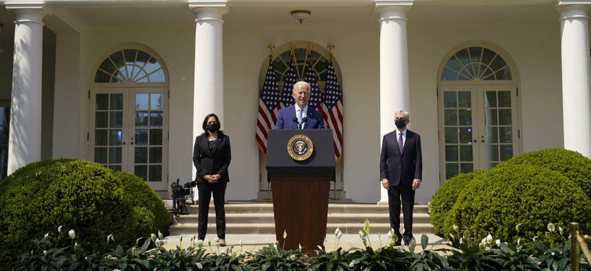 President Joe Biden, accompanied by Vice President Kamala Harris, and Attorney General Merrick Garland, speaks about gun violence prevention in the Rose Garden at the White House, Thursday, April 8, 2021, in Washington.