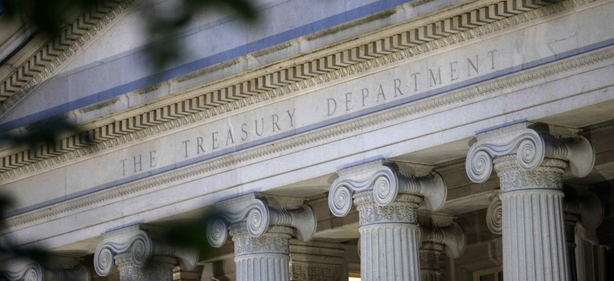 The U.S. Treasury Department building at dusk in Washington.