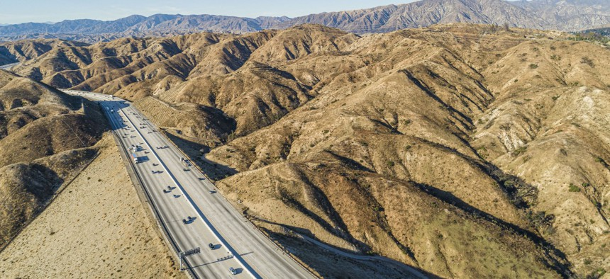 The aerial view of the Ronald Reagan Freeway in the California mountains, nearby Los Angeles and La Canada.
