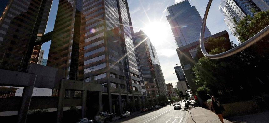 In this 2018 photo, the sun beats down on downtown Phoenix. Phoenix is one of many cities poised to receive tens of millions of dollars in federal relief funding.