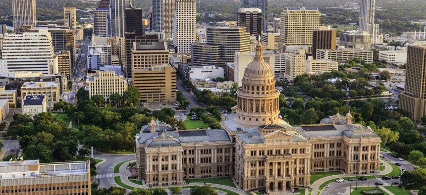 Aerial view of Capitol building in Austin the Capital of Texas with downtown Austin skyscrapers in background.