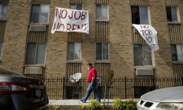 "In this May 20, 2020, file photo, signs that read ""No Job No Rent"" hang from the windows of an apartment building during the coronavirus pandemic in Northwest Washington."