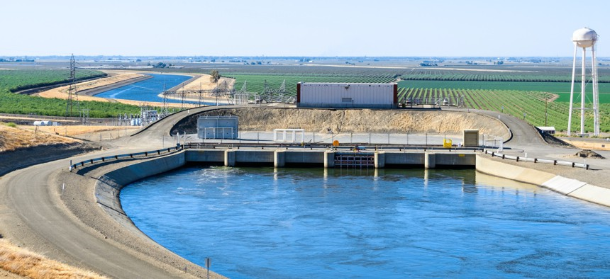"""The """"Dos Amigos"""" pumping plant pushes water up hill on the San Luis Canal, part of the California Aqueduct system; Los Banos, central California."""