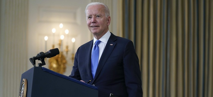 President Joe Biden takes questions from reporters as he speaks about the American Rescue Plan, in the State Dining Room of the White House.