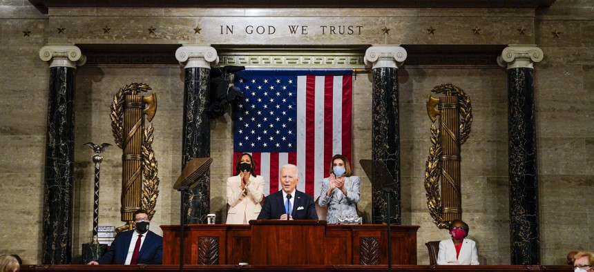 Vice President Kamala Harris and House Speaker Nancy Pelosi of Calif., stand and applaud as President Joe Biden addresses a joint session of Congress, Wednesday, April 28, 2021, in the House Chamber at the U.S. Capitol in Washington.