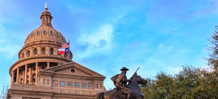 The Texas Ranger statue in front of the Texas Capital building in Austin, TX.