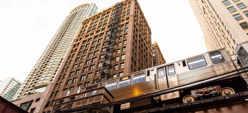 An L train passes in front of buildings in Chicago. The city is set to receive one of the biggest funding allotments among cities from a federal aid program.