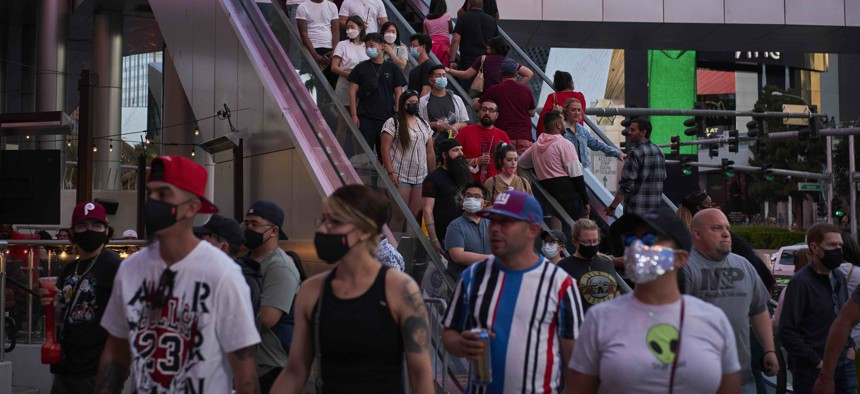 People ride an escalator along the Las Vegas Strip, Saturday, April 24, 2021, in Las Vegas. Nevada was one of the states that took a larger hit to its budget as tourism dropped during the pandemic.