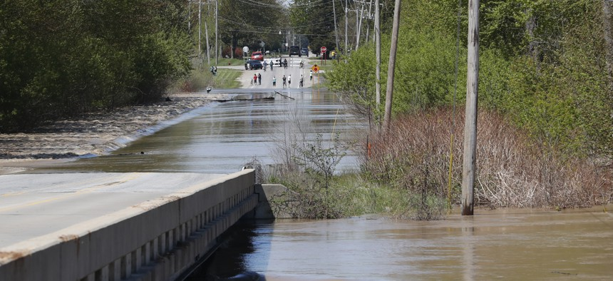 The Tittabawassee River overflows, Wednesday, May 20, 2020, in Freeland, Michigan.