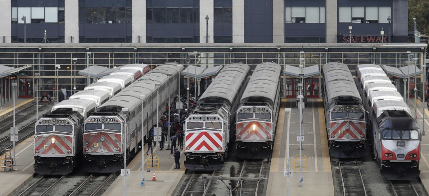 This Wednesday, Oct. 16, 2019, file photo shows trains at a Caltrain station in San Francisco.