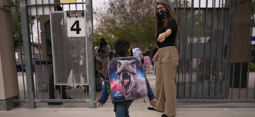 A student leaves after the first day of in-person learning at Maurice Sendak Elementary School in Los Angeles in April 2021. Education job losses account for most of the employment declines in the state and local public sector during the pandemic.