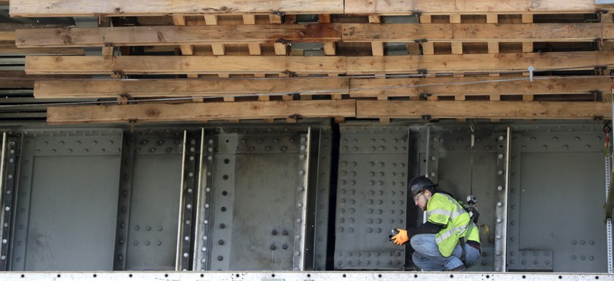 A worker labors on the beam of the Route 495 viaduct during a project to remodel the bridge which feeds into the Lincoln Tunnel in North Bergen, N.J., Tuesday, April 23, 2019.