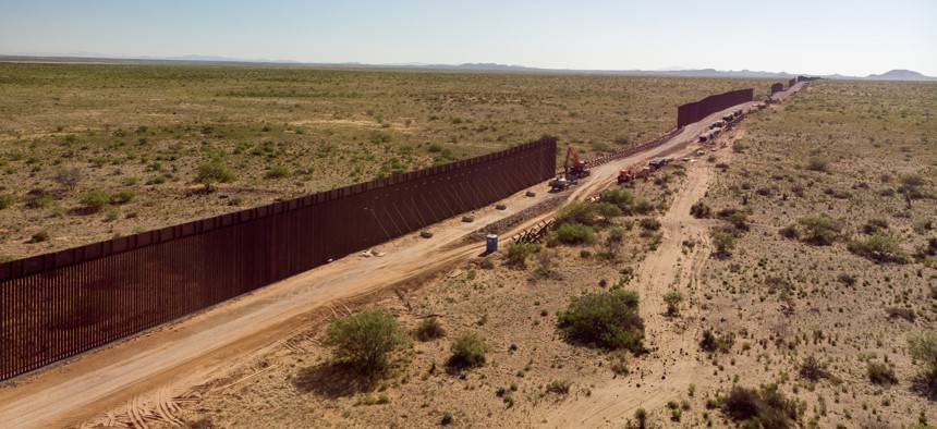 A Texas Border Wall with sections that are still under construction.
