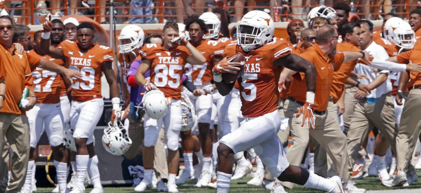 Texas defensive back runs a blocked field goal attempt back for a touchdown against Maryland during an NCAA college football game in Austin, Texas.