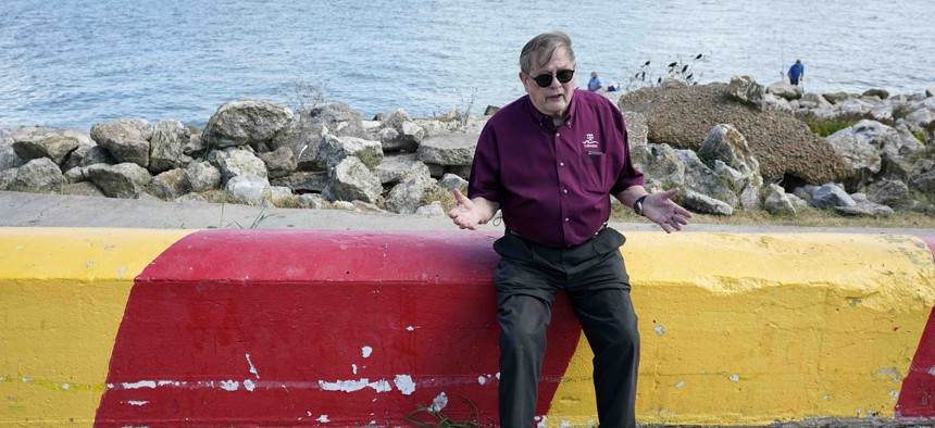 Bill Merrell, a professor in the Marine Sciences Department at Texas A&M University at Galveston and a former president of the school, sits along Galveston Bay as he talks about the Ike Dike project in Galveston, Texas.