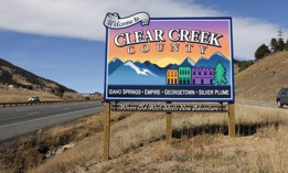 A welcome sign for Clear Creek County, Colorado along Interstate 70.