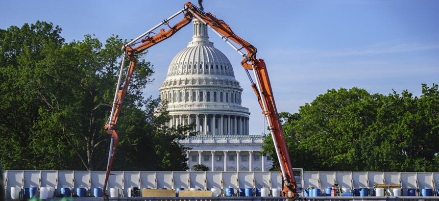 A concrete pump frames the Capitol Dome during renovations and repairs to Lower Senate Park, on Capitol Hill in Washington, Tuesday, May 18, 2021. President Joe Biden hopes to pass a massive national infrastructure plan by this summer.