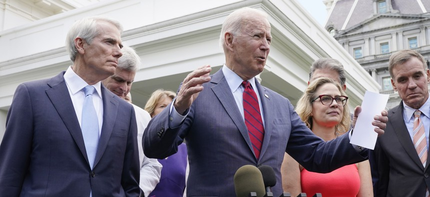 President Joe Biden, with a bipartisan group of senators, speaks Thursday June 24, 2021, outside the White House in Washington. Biden invited members of the group of 21 Republican and Democratic senators to discuss the infrastructure plan.