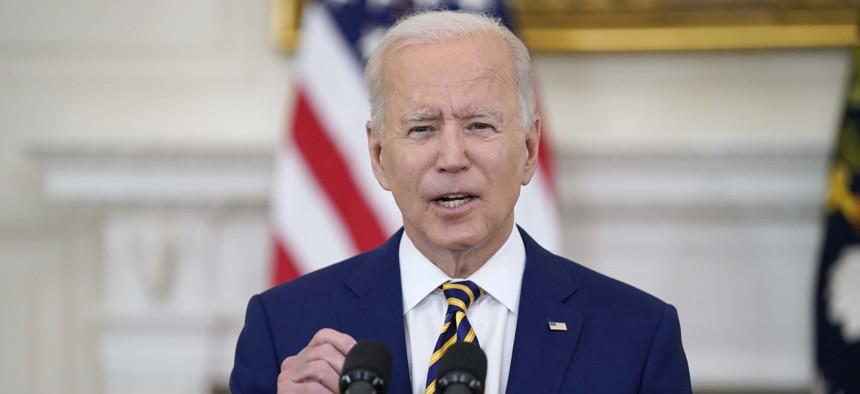 President Joe Biden speaks in the State Dining Room of the White House in Washington.