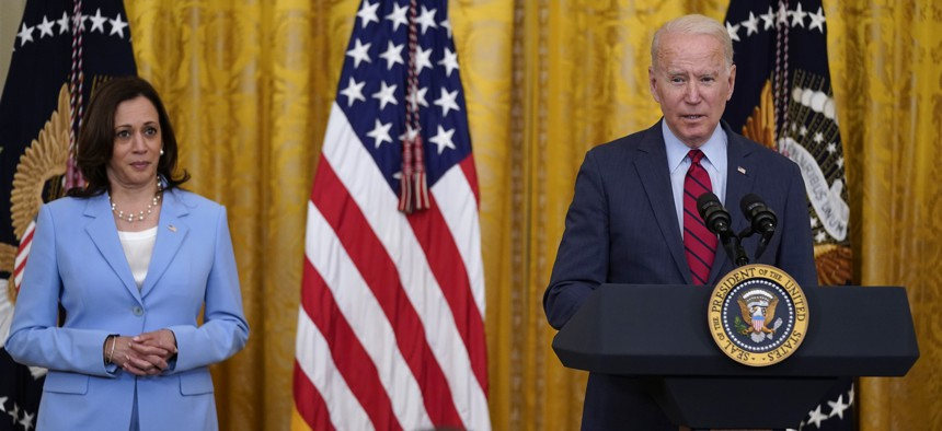 President Joe Biden speaks about infrastructure negotiations, in the East Room of the White House, Thursday, June 24, 2021, in Washington. Vice President Kamala Harris stands at left.