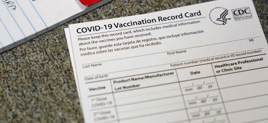 In this December 2020, file photo, a COVID-19 vaccination record card is shown at Seton Medical Center in Daly City, Calif.