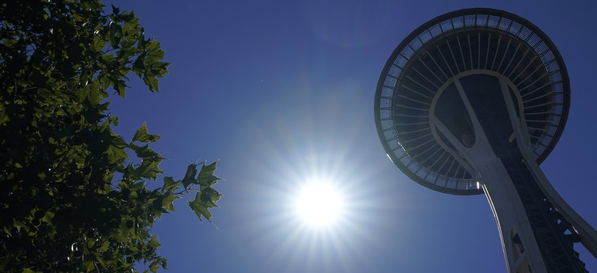 The sun shines near the Space Needle, Monday, June 28, 2021, in Seattle. Seattle and other cities broke all-time heat records over the weekend, with temperatures soaring well above 100 degrees Fahrenheit.
