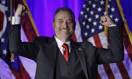Ohio Attorney General Dave Yost pumps his fists before speaking at the Ohio Republican Party event, Tuesday, Nov. 6, 2018, in Columbus, Ohio.