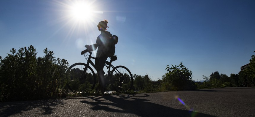 Gregory Matarazzo takes a break from cycling as the temperatures hovered over 100 degrees in Missoula, Montana, on Wednesday, June 30, 2021.