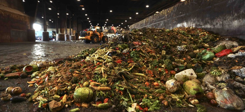 """In this Aug. 29, 2018, photo, at the Waste Management facility in North Brooklyn, tons of leftover food sits piled up before being processed into """"bio-slurry,"""" in New York. The """"bio-slurry"""" can be turned into methane gas at a nearby wastewater treatment plant."""