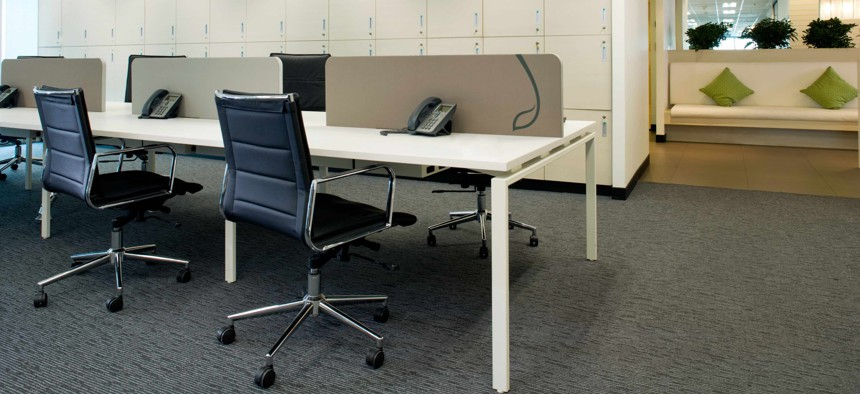 An open office space with storage lockers.